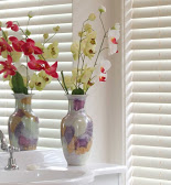 Venetian Blinds with flower pot in front